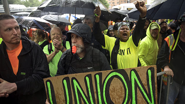 Union members and construction workers hold a rally on May 22 in Columbus Circle in New York City. (Drew Angerer/Getty Images)