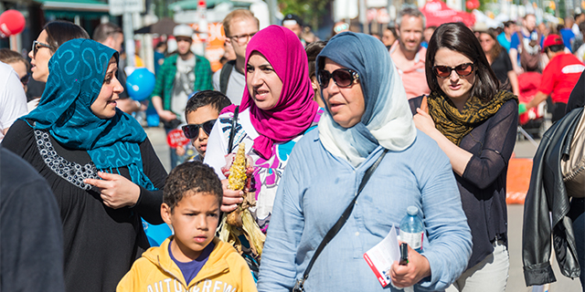 LITTLE PORTUGAL, TORONTO, ONTARIO, CANADA - 2015/06/06: Islam women wearing hijab in North American city, Multicultural city celebrates together the Dundas West Festival in Little Portugal, the festival is a traditional event held every year. (Photo by Roberto Machado Noa/LightRocket via Getty Images)