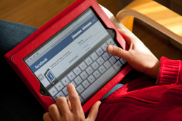 Person using Facebook on ipad : promo image
