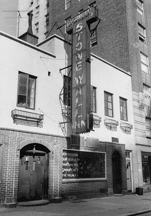 "The Stonewall Inn, taken September 1969. The sign in the window reads: ""We homosexuals plead with our people to please help maintain peaceful and quiet conduct on the streets of the Village—Mattachine"". (Author: Diana Davies, copyright owned by New York Public Library, via Wikimedia Commons)"