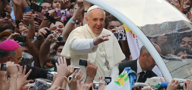 Pope Francis waves to the crowd while departing the Metropolitan Cathedral in the Popemobile after arriving in Rio on July 22, 2013 in Rio de Janeiro, Brazil. Credit: Getty Images