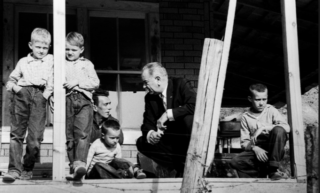 President Lyndon Baines Johnson visit to Tom Fletcher's home in Kentucky was part of a tour of poverty stricken areas of the U.S. (Photo by Walter Bennett/Time & Life Pictures/Getty Images).