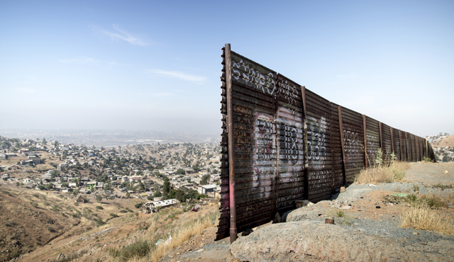 A gap in the fence near the U.S.-Mexico border overlooking Tijuana, Mexico, in 2014. (Photo by Charles Ommanney/Reportage by Getty Images)