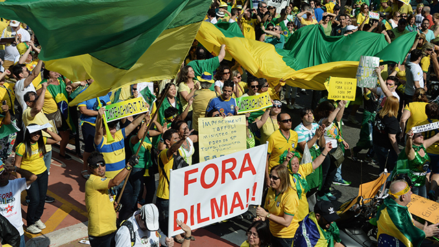 Demonstrators protest against Brazilian President Dilma Rousseff and the ruling Workers' Party (PT), at Paulista Avenue in Sao Paulo, Brazil, on Aug., 16, 2015. Photo Credit: Nelson Almeida/AFP/Getty Images