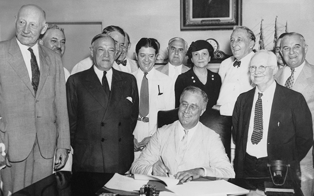 President Franklin D. Roosevelt signs the Social Security Act, 14th August 1935. (Photo by FPG/Archive Photos/Getty Images)