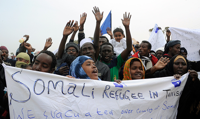 Somali refugees fleeing Libya demonstrate at the Choucha refugee camp near the Tunisian border in March 2011. (Dominique Faget/AFP/Getty Images)