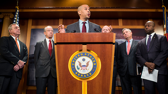 Sen. Cory Booker, D-N.J., flanked from left by Senate Minority Whip Dick Durbin, D-Ill., Senate Judiciary Chairman Chuck Grassley, R-Iowa, Senate Judiciary ranking member Pat Leahy, D-Vt., Sen. Sheldon Whitehouse, D-R.I., and Sen. Tim Scott, R-S.C., speaks during a news conference on criminal justice reform legislation in October 2015. (Photo By Bill Clark/CQ Roll Call)