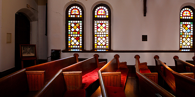 Photo of empty pews in a church