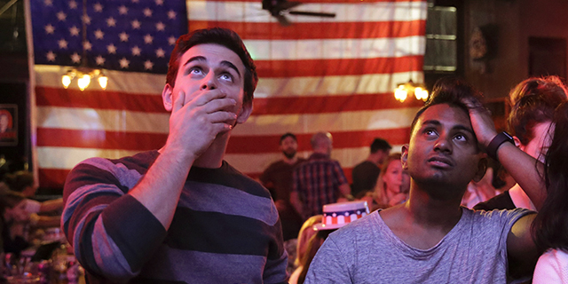 Supporters of presidential candidate Hillary Clinton watch televised coverage of the U.S. presidential election at Comet Tavern in the Capitol Hill neighborhood of Seattle on Nov. 8, 2016. (Photo by Jason Redmond/AFP/Getty Images)