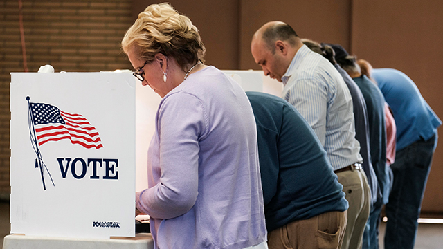 Voters cast their ballots at a fire station in Alhambra, California, on Nov. 8, 2016. (Ringo Chiu/AFP/Getty Images)