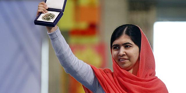Nobel Peace Prize laureate Malala Yousafzai displays her medal during the Nobel Peace Prize awards ceremony in Oslo on Dec. 10, 2014. (Cornelius Poppe/AFP/Getty Images)