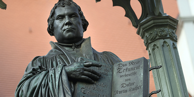 A statue of Martin Luther in Market Square in Wittenberg, Germany. In 1517 Luther nailed his 95 theses to a door of nearby Schlosskirche church, helping to spark the Protestant Reformation. (Sean Gallup/Getty Images)