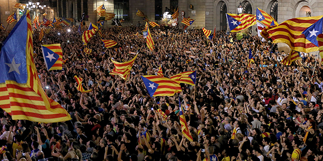 People gather at Placa Sant Jaume in Barcelona, Spain, to celebrate after Catalonia's parliament declares an independent Catalan republic on Oct. 27. (Pau Barrena/AFP/Getty Images)