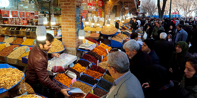 Iranians shop at Tehran's ancient Grand Bazaar on Jan. 4. (Atta Kenare/AFP/Getty Images)