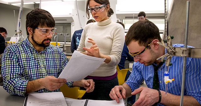 Teaching assistant Camille Lombard talks with students Bijan Ameli, left, and Mike Feigenbaum in a chemistry class at George Washington University in Washington, D.C., in 2015. (Linda Davidson/The Washington Post via Getty Images)