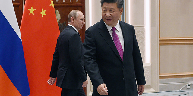 Chinese President Xi Jinping, foreground, with Russian President Vladimir Putin in Hangzhou, China, in September 2016 as world leaders assembled for the 11th G20 Summit. (Wang Zhou - Pool/Getty Images)