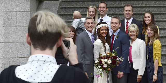 Members of a wedding party pose after a Mormon ceremony at Salt Lake Temple in Salt Lake City. (Robert Alexander/Getty Images)