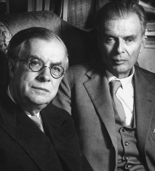 Scientist Dr. Julian Huxley (L) sitting in same armchair w. his brother, author Aldous Huxley. Photo by Wolf Suschitzky/Pix Inc./The LIFE Images Collection/Getty Images