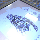Sketches of the Tactical Assault Light Operator Suit (TALOS) at the Special Operations Forces Industry Conference in Tampa, Fla. on May 20, 2014