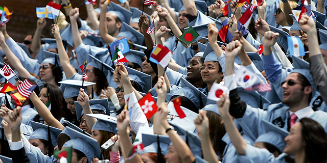 Students cheer during commencement ceremonies at Columbia University in New York City. (Spencer Platt/Getty Images)