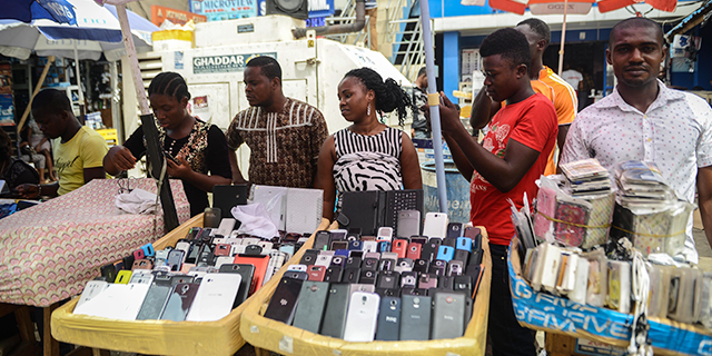 Nigerians buy and sell mobile phones, computers and other devices at a popular electronics bazaar in Ikeja, a suburb of Lagos, in 2015. (Mohammed Elshamy/Anadolu Agency/Getty Images)