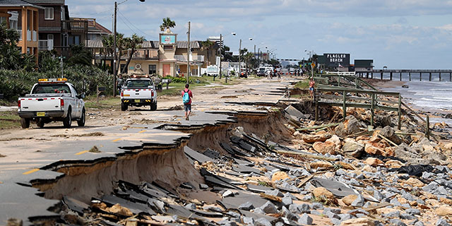 A road in Flagler Beach, Florida, washed out by ocean waters stirred up by Hurricane Matthew in October 2016. (Joe Raedle/Getty Images)