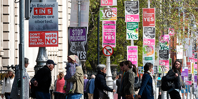 A Dublin street filled with signs for both sides ahead of Ireland's May 25 referendum on abortion. The country overwhelmingly voted to overturn the constitutional amendment banning most abortions. (Artur Widak/AFP/Getty Images)