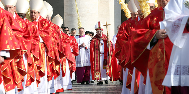 Pope Francis, flanked by cardinals, arrives in a procession at St. Peter's Square in late March, in Vatican City. (Franco Origlia/Getty Images)