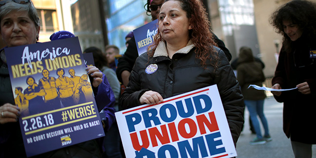 Union members hold a rally at Richard J. Daley Center in Chicago on Feb. 26. (Scott Olson/Getty Images)