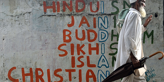 Graffiti on a Mumbai wall. (Indranil Mukherjee/AFP/Getty Images)