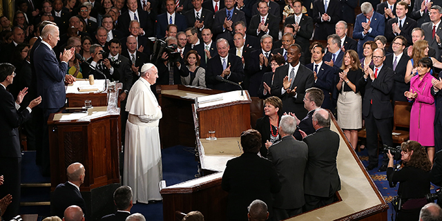 WASHINGTON, DC - SEPTEMBER 24: Pope Francis is applauded by members of Congress as he arrives to speak during a joint meeting of the U.S. Congress in the House Chamber of the U.S. Capitol on September 24, 2015 in Washington, DC. Pope Francis is the first pope to address a joint meeting of Congress and will finish his tour of Washington later today before traveling to New York City. (Photo by Win McNamee/Getty Images)