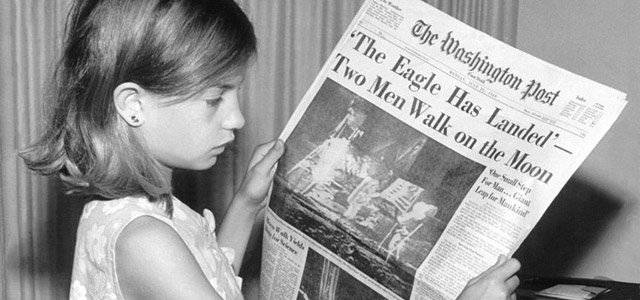 A girl holds The Washington Post on Monday, July 21, 1969 / Jack Weir