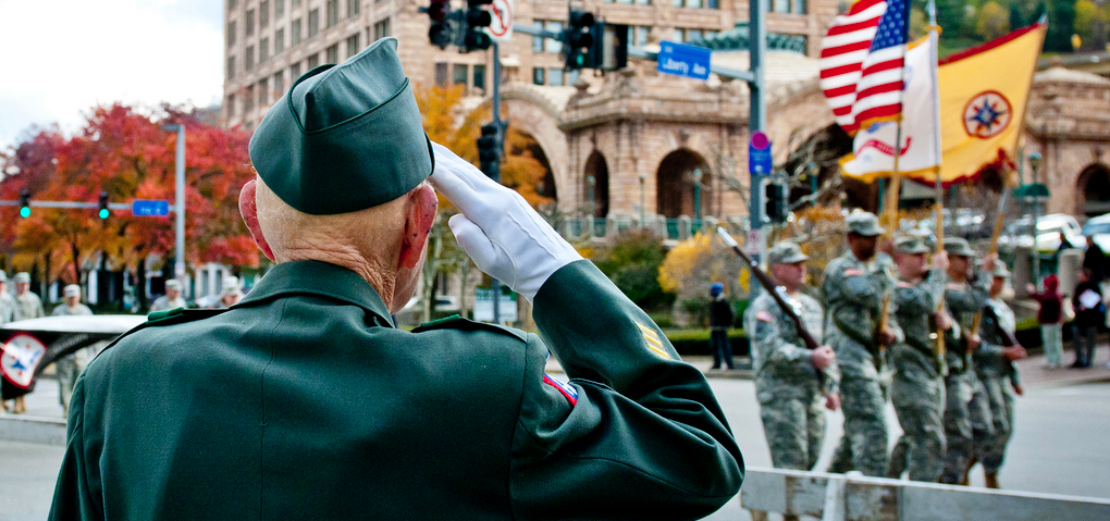 Veteran Salutes Flag During Parade