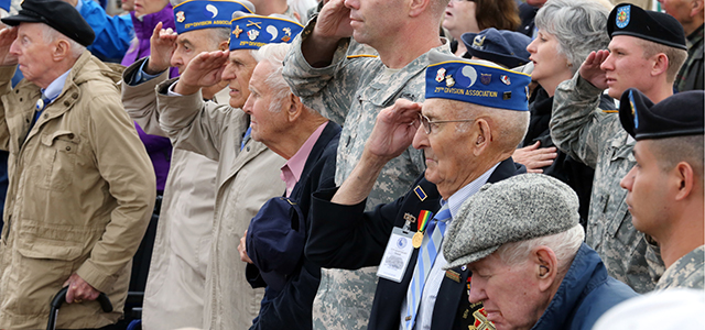 U.S. WW II veteran Arden C. Earll, right, from Erie, Pennsylvania, landed on Omaha Beach on June 6, 1944, with the 116th infantry regiment, salutes along with other WW II veterans as part of the commemoration of the 70th D-Day anniversary, Credit: AP Photo/Remy de la Mauviniere