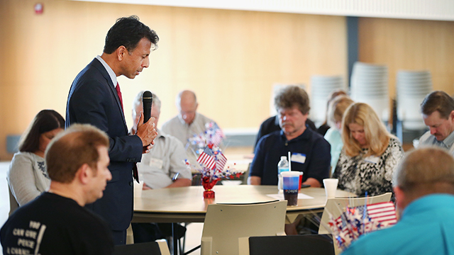 Louisiana Gov. Bobby Jindal leads guests in prayer last month at the Story County GOP breakfast at Oakwood Church in Ames, Iowa. (Photo by Scott Olson/Getty Images)