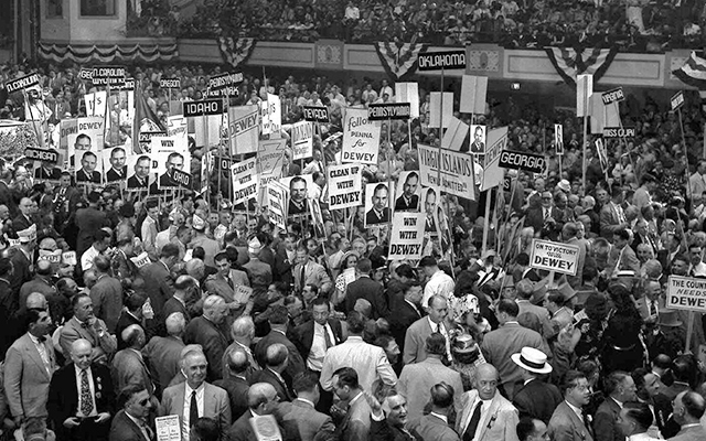 Delegates crowd down the center aisle at the 1948 Republican National Convention in Philadelphia during a demonstration for Gov. Thomas E. Dewey. Dewey was the last Republican presidential candidate to be nominated in a multi-ballot contest; he won on the third ballot. Photo credit: AP photo