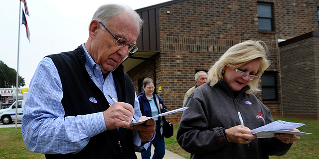Terry and Mary Ann Williams fill out exit polls conducted by Edison Research after voting at the Bayleaf Volunteer Fire Department on November 6, 2012 in Raleigh, North Carolina. Photo by Sara D. Davis/Getty Images