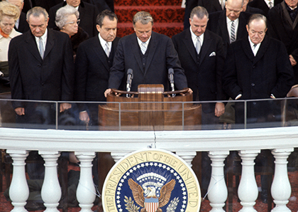 The Rev. Billy Graham, center, offers a prayer at the presidential inauguration of Richard Nixon on Jan. 20, 1969. Graham's son, the Rev. Franklin Graham, is scheduled to give a benediction at Donald Trump's inauguration on Jan. 20, 2017.